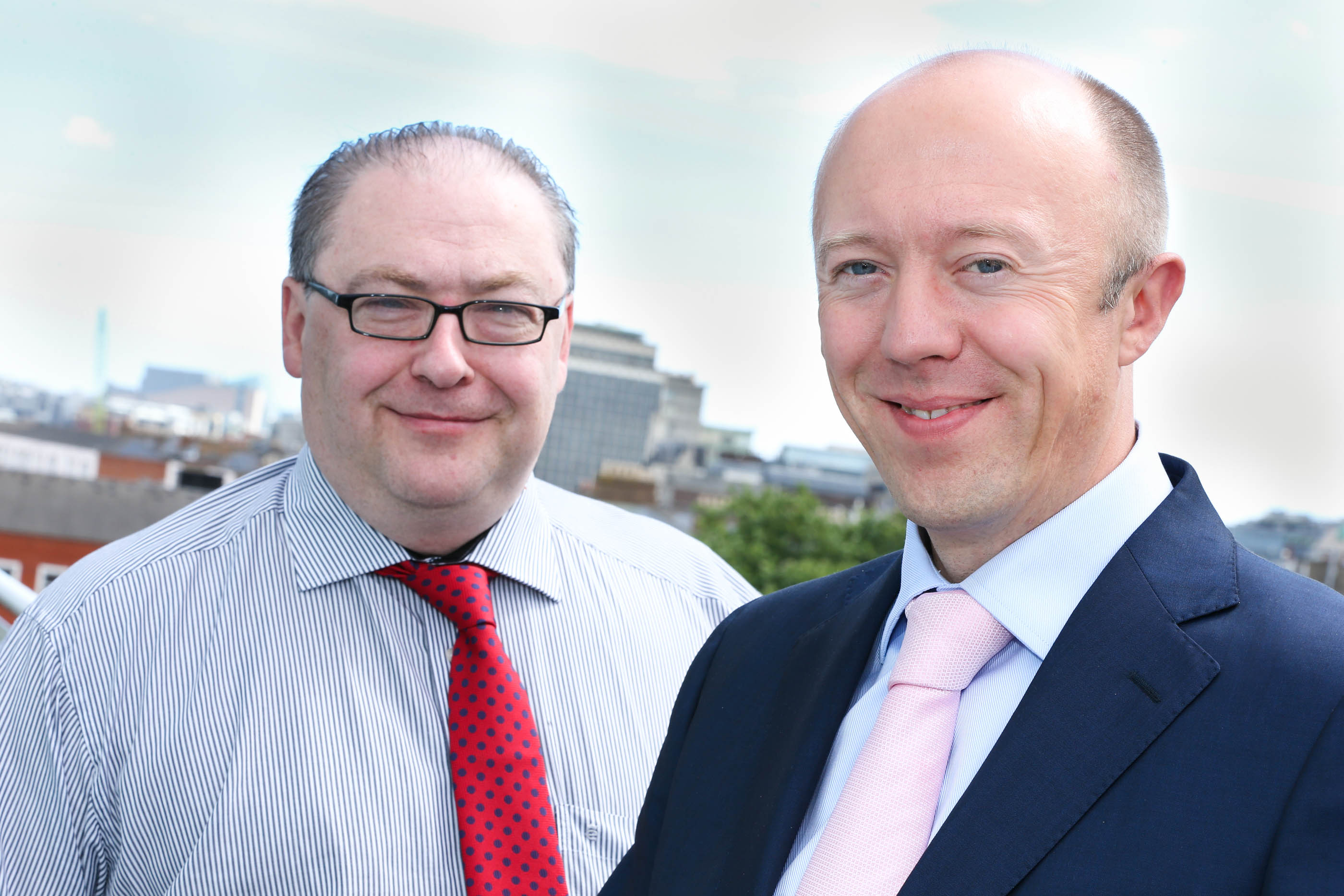 Pictured announcing the deal: Andrew Hillis, Group Head of Information Services, at Almac Group (Left) and Tom O'Connor, Director, Version 1 (Right).
