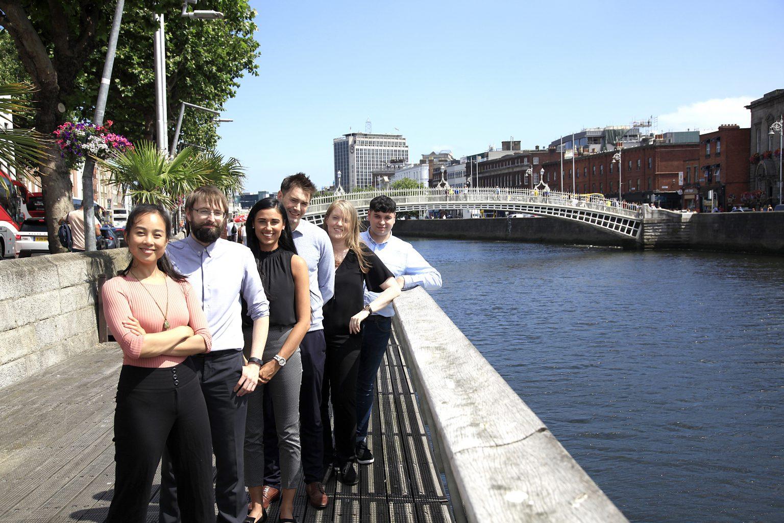 Graduates at river