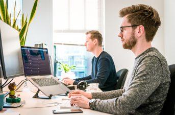 man looks at desktop